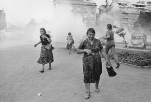 Women suffer from tear gas during a demonstration against Pinochet on International Women's Day. Santiago; Chile, 1985