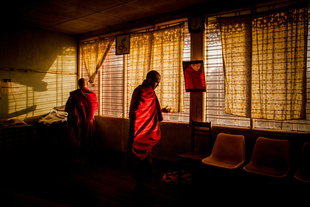 Monks at their home before morning alms in Mytchina, Myanmar.