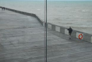 Man walking on Pier