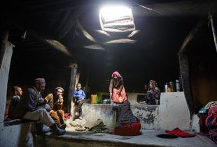 A Wakhi family inside a typical Wakhi house.