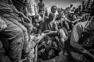 Bengladeshi migrants begged to be released from the hold of a boat carrying 414 men, women and children where they had been for over 14 hours