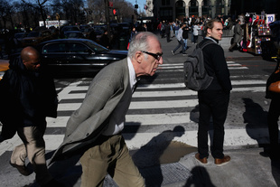 Lunging man, 5th Avenue. © Shane Gray. Chosen for the LensCulture Street Photography Awards Top 100.