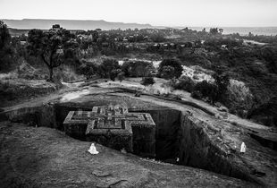 Pilgrims praying at The Church of Saint George, one of eleven rock-hewn monolithic churches in Lalibela, Ethiopia.