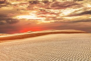 Sunset over great sand dunes in New Zealand