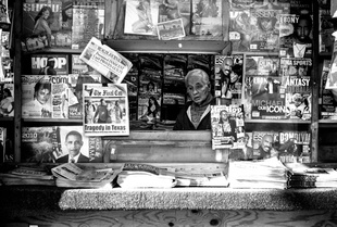 Newsstand vendor looks out at S. Lake Park & E. 53rd Street.