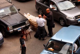Negotiating about bread's price in the middle of a crossroad