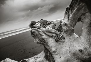 Asleep in his mother's arms (Manchester Beach)