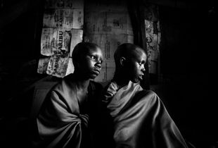 Maasai-girls Isina & Nasirian are sitting in their father's hut a day before the planned circumcision. © Meeri Koutaniemi