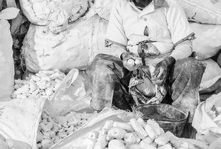 "Women Workers. Cassava flour seller. Vendedora de ""fuba de bombó"" in angolan language."