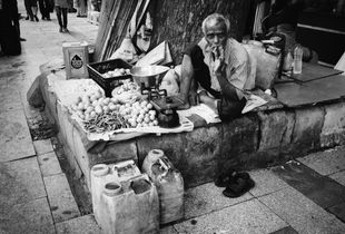 Old monger waiting for customers outside the market, Delhi India, 2017