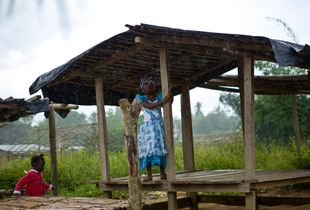 Safe at last: a displaced girl shelters from the rain and attacks in Côte d'Ivoire