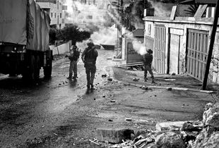 Israeli IDF enter Aida Camp with Tear gas, rubber bullets and dirty water. © Will Hilton