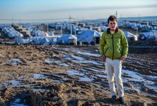 A young Iraqi boy stands at the entrance of his new home - a camp for Internally Displaced Persons in Kurdistan, Iraq.