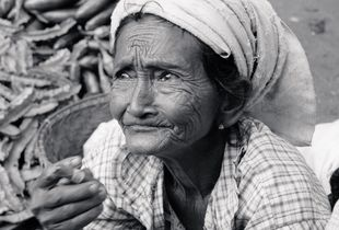 An old woman with a cigar