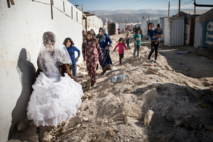 Wedding Day. Khaldiye, a 27-year-old Syrian refugee, just had her hair and make-up done in one of the numerous settlements in Lebanon before attending her wedding later that same day. © Asger Ladefoged. Chosen for the LensCulture Street Photography Awards Top 100.