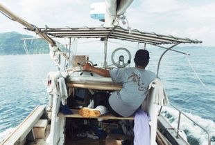 Mr. Okamoto, one of Iwaishima's fishermen, comes home from a day out on the Seto Sea.
