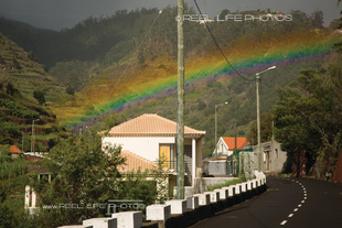 Really wide rainbow over the mountains above Ponta do Sol, Madeira.