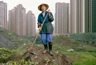 Ren Yidi, an urban farmer in Chongqing. Yidi was once a rural farmer but then he left the countryside and was given two sets of apartments in the city of Chongqing.
