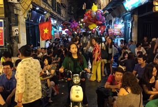 GIrl on bike at Hanoi