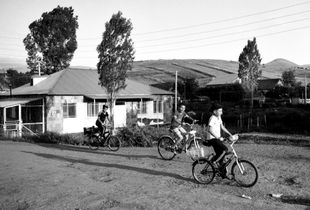 Local children riding their bicycles.