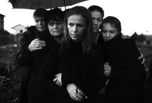 According to Albanian tradition, men and women attending funerals in separate groups. Tirana, Albania © Enri Canaj