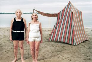 My grand parents at the beach posing in front of their tent.