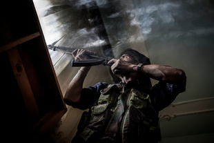 A FSA fighter shooting against the positions of the Syrian loyalist Army