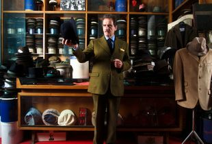 Lucino Viganò in his hat shop