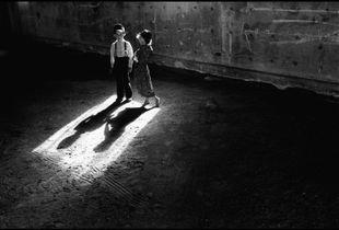 © George Webber - Children in machine shed, 1999