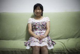 Wang Hui sitting in the living-room