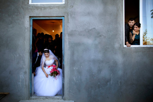 Bride, 17, leaving her house for her wedding ceremony. She met her future husband on the day of her engagement. Early marriages occur mainly in the Kvemo Kartli  and Ajara regions. Kakheti Region. Georgia, 2014.