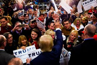 Republican presidential candidate Donald Trump works the rope line during a campaign rally at Pennichuck Middle School in Nashua on Monday, Dec. 28, 2015.
