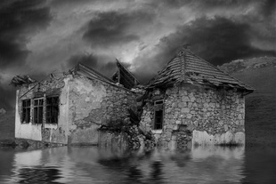 Bombed, flooded house