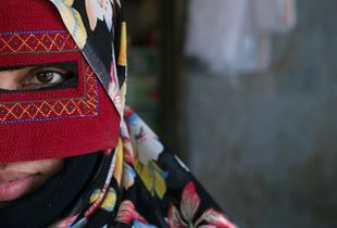 The masked woman