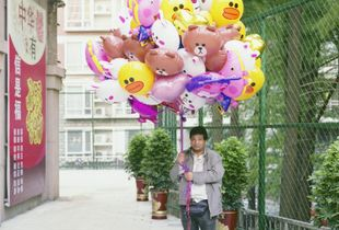 Balloon seller.  Hanjie Street, Wuhan.