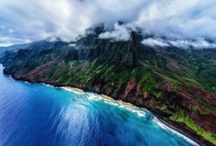 Approaching Paradise/The clouds began to break as we flew over the Pacific towards the Na Pali Coast