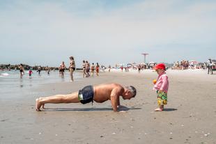 Beach Body Bingo. Boy with Orange Ball. © Donato Dicamillo. Chosen for the LensCulture Street Photography Awards Top 100.