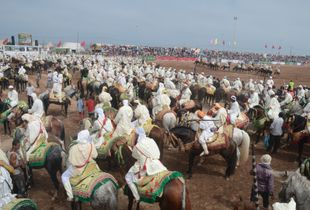 The corralling sorba ( riding troops ) wait anxiously before forming charge lines. Moulay Abdellah Amghar , Doukkala, Morocco
