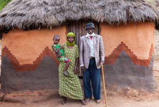 Family from Borana Tribe posing in front of their house.