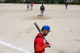 "A team player ""Dream Team"" prepares to bat.d"