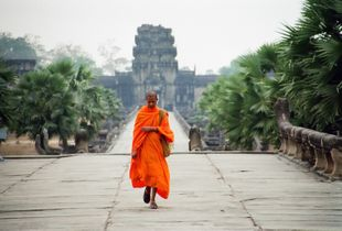 Buddhist Monk arriving at Angkor Wat