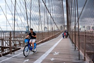 Biker on Brooklyn bridge