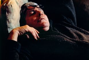 Sleeping Man with Eyeglasses Pusked Back