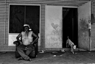 Christmas morning in One Mile Community, a large community of poverty and dysfunction