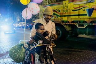 Father and son in the Mumbai nigh.