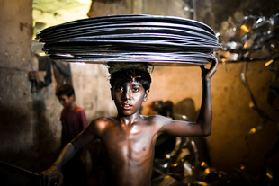 MAHIN is 10-year-old boy who works in an aluminum factory where different kinds of jars and pots are made. He lives in Dhaka with other workers of the same factory.