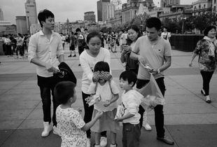 Kids. Photographing along the Huangpu River through the city of Shanghai, China.
