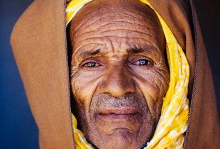 Elderly Amazigh man wearing a tradtional Moroccan djellaba, Assaiss market, Taliouine, Morocco.
