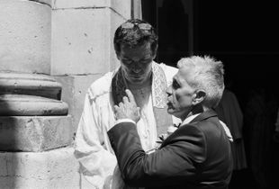 A priest listens intently to the father of the bride, St. Tropez. France. 2017.