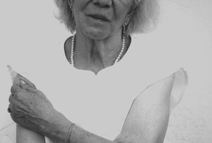 "Anni Schmidt was a Sinti woman and was deported in World War II to the Ausschwitz Concentration Camp run by the Nazis, proved by ""the Registration number"" she is still bearing on her arm ."